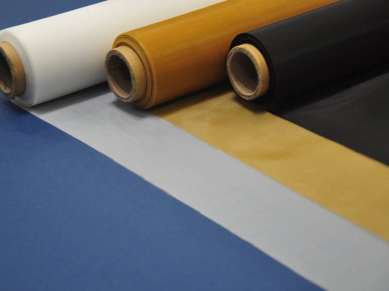 Three rolls of polyester filter mesh with white, yellow and black color.