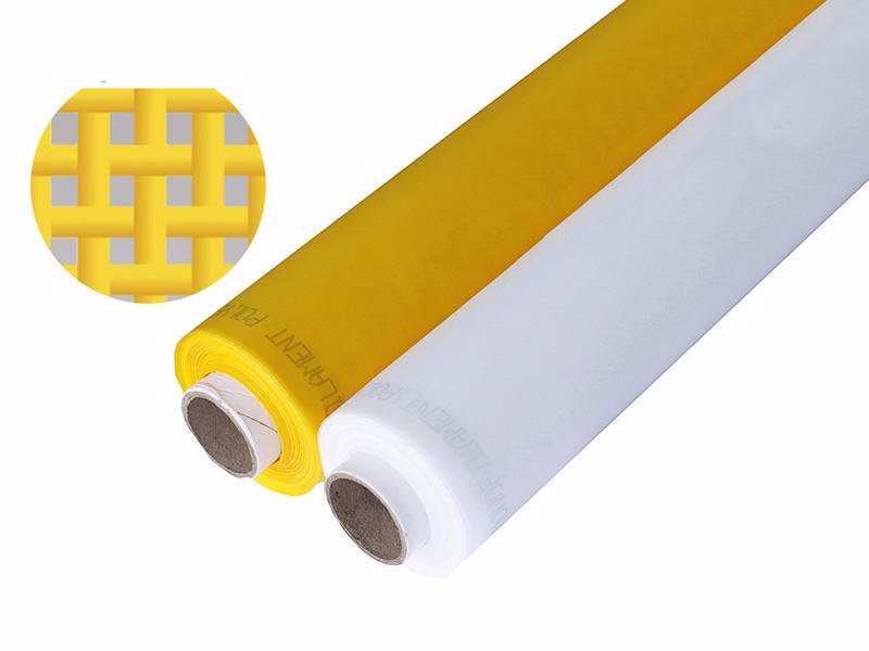 A roll of white and a roll of yellow polyester printing screen mesh on white background.