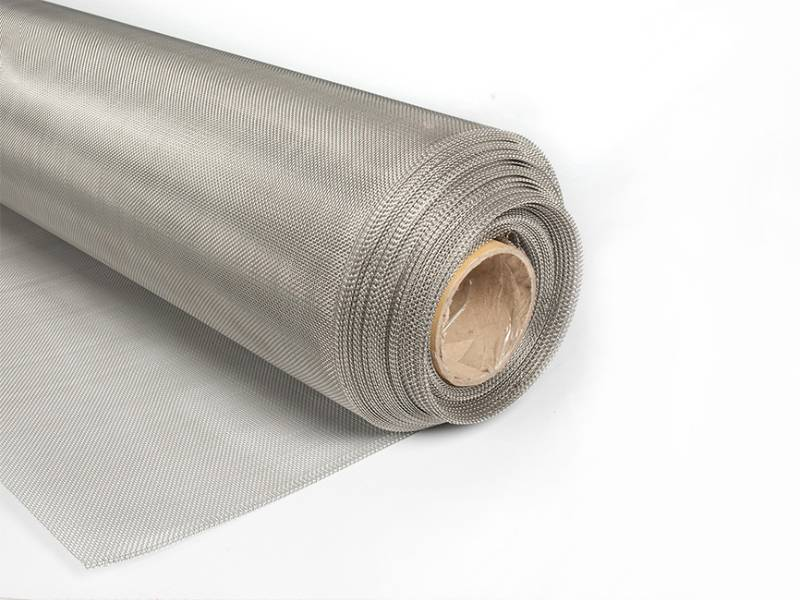 A roll of stainless steel filter mesh on gray background.